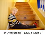 cute little boy in striped... | Shutterstock . vector #1233542053