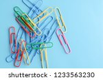 colorful paper clips on blue.... | Shutterstock . vector #1233563230