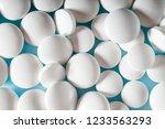 medicine pills background.... | Shutterstock . vector #1233563293