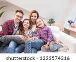 family lifestyle portrait of a... | Shutterstock . vector #1233574216