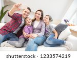 family lifestyle portrait of a... | Shutterstock . vector #1233574219