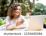 young woman in cafe reading a...   Shutterstock . vector #1233600286
