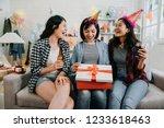three friends sharing happy... | Shutterstock . vector #1233618463