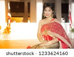 the pretty thai lady in middle... | Shutterstock . vector #1233624160