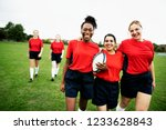 energetic female rugby players... | Shutterstock . vector #1233628843