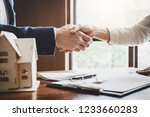 real estate agent and customers ... | Shutterstock . vector #1233660283