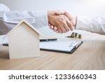 real estate broker agent and... | Shutterstock . vector #1233660343