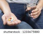 close up hand man taking... | Shutterstock . vector #1233675880