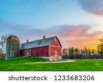 Red wood barn farm sunset