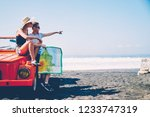 male and female tourist making... | Shutterstock . vector #1233747319