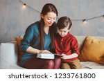 happy mother reading book to... | Shutterstock . vector #1233761800