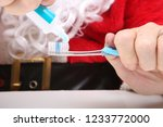 santa claus tooth brushing....   Shutterstock . vector #1233772000