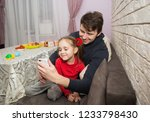dad and daughter play mobile...   Shutterstock . vector #1233798430