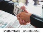 corrupted businessman sealing... | Shutterstock . vector #1233830053