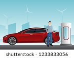 man charges an electric car at... | Shutterstock .eps vector #1233833056