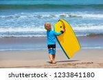 baby boy   little surfer run... | Shutterstock . vector #1233841180