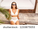 girl on a tropical beach in... | Shutterstock . vector #1233875053