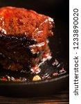 juicy beef steak and herbs... | Shutterstock . vector #1233890020