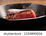 juicy beef steak on cast iron... | Shutterstock . vector #1233890026