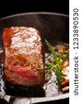 juicy beef steak and herbs... | Shutterstock . vector #1233890530