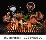 grilled beef steaks with... | Shutterstock . vector #1233900820