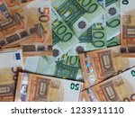 50 and 100 euro banknotes money ... | Shutterstock . vector #1233911110