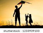 happy parent with children... | Shutterstock . vector #1233939103