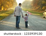 happy father and son walk in... | Shutterstock . vector #1233939130