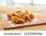 crispy fried chicken in a... | Shutterstock . vector #1233984406