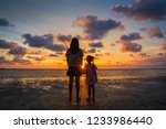 mother and daughter holding... | Shutterstock . vector #1233986440