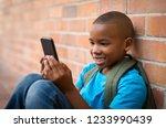 happy african student wearing... | Shutterstock . vector #1233990439