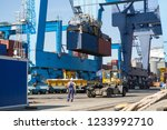 industrial port with containers.... | Shutterstock . vector #1233992710