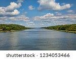 waterway kiel canal with clouds | Shutterstock . vector #1234053466