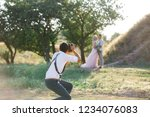wedding photographer takes... | Shutterstock . vector #1234076083