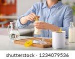 woman preparing baby formula at ... | Shutterstock . vector #1234079536