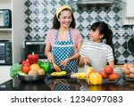 mother and daughter asian... | Shutterstock . vector #1234097083