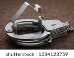Small photo of Concept on roguish actions with the real estate and its arrest. Handcuffed house figure