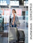 young woman with her luggage at ... | Shutterstock . vector #1234129513