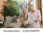 mature couple visiting... | Shutterstock . vector #1234144999
