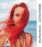 woman with red hair on vacation ...   Shutterstock . vector #1234145686