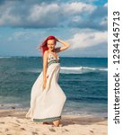 woman with red hair on vacation ...   Shutterstock . vector #1234145713
