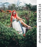 woman with red hair on vacation ...   Shutterstock . vector #1234148116