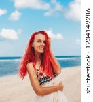 woman with red hair on vacation ...   Shutterstock . vector #1234149286