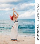 woman with red hair on vacation ...   Shutterstock . vector #1234149730