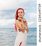 woman with red hair on vacation ...   Shutterstock . vector #1234149739