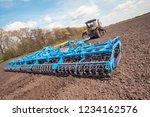 farmer in tractor preparing... | Shutterstock . vector #1234162576