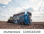 farmer in tractor preparing... | Shutterstock . vector #1234163140