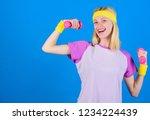 girl exercising with dumbbell.... | Shutterstock . vector #1234224439