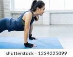 asian women exercise indoor at... | Shutterstock . vector #1234225099