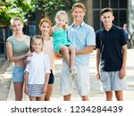 portrait of parents with four... | Shutterstock . vector #1234284439